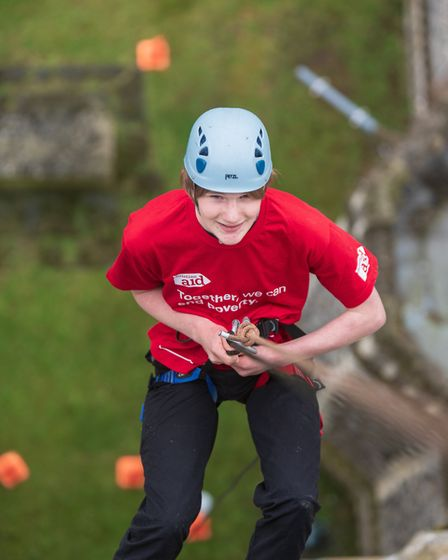 Leonard Haworth abseils from St Mary's Church in Redenhall to raise money for Christian Aid. Picture