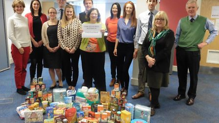 Colleagues at the Ipswich office of Savills with some of the food being donated to Families in Need