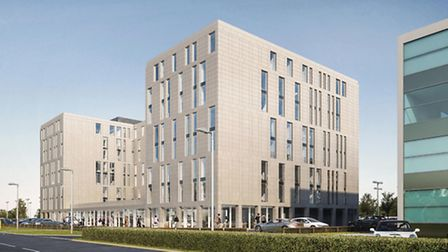 An artist's impression of the new Hampton by Hilton hotel to be built and Stansted Airport,alongside