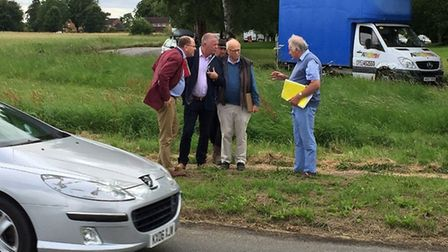 Mid-Norfolk MP George Freeman and officials at the site where a new pedestrian crossing is being bui