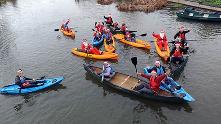 The charity Santa Paddle boats set off on the River Stour at Sudbury.