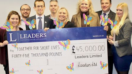Estate agents Leaders raise �45,000 for charity. Leaders� COO, Clare Tobin (3rd from right) and Lea