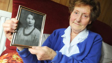 Jean Batram holding a photograph of her biological mother who she did not meet until she was 45-year
