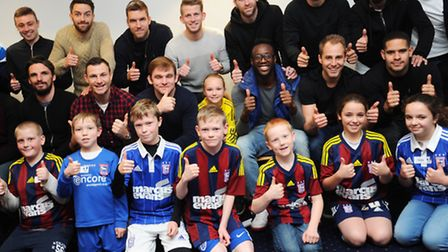 Junior Blues Christmas party at Portman Road. Town player showing their appreciation to the young bl