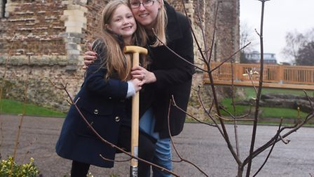 Jessica dines and mum Nicola planting a tree grown from a seed from the Colchester castle tree