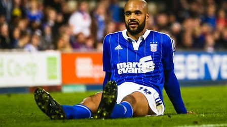 David McGoldrick sits on the pitch after getting fouled late on in the Ipswich Town v Cardiff City (