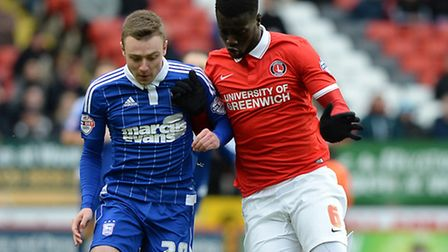 Naby Sarr and Freddie Sears chase the ball at The Valley