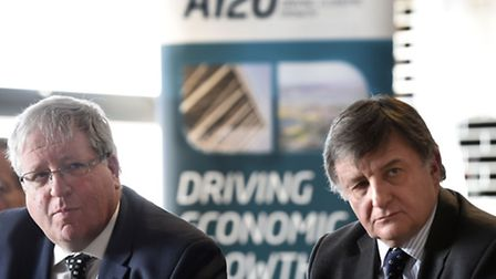 Secretary of State for Transport the Patrick McLoughlin (left) sitting with Haven Gateway Partnershi