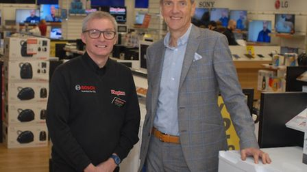 Robert Hughes, managing director of Hughes Electrical, and Andy Yallop, store manager, at the compan