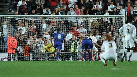 Neil Alexander goes the wrong way as Kevin Gallen gives the Dons a last gasp equaliser to take the g