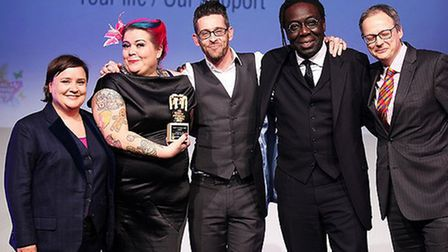 The Leading Lives team receive their tropy at the Social Enterprise UK Awards in London.