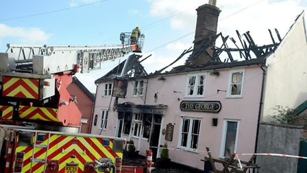 Fire Fighters work on damping down the fire at The George Pub in Wickham Market that caught fire in
