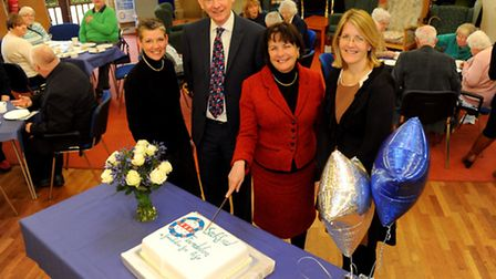 The Lord Lieutenant of Suffolk Lady Clare Euston cuts the cake to officially opens the new Seckford