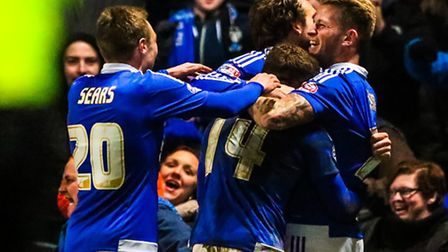 Ipswich Town players surround Brett Pitman after he had scored the late winner in the Ipswich Town v