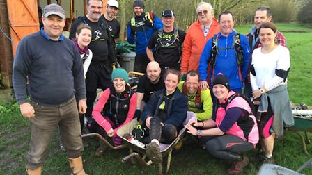 Holly Gibson (in wheelbarrow) with Dale Green (front left), Spencer Greystrong (in the orange coat)