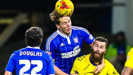 Christophe Berra gets over Mirco Antenucci to head the ball late in the Ipswich Town V Leeds United