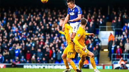 Jonas Knudsen gets the better of Eoin Doyle and Calum Woods during the Ipswich Town v Preston North