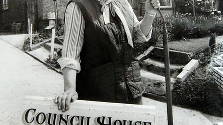 An archive photograph of Peggy Cole at her home n Charsfield, where she used to open her garden for