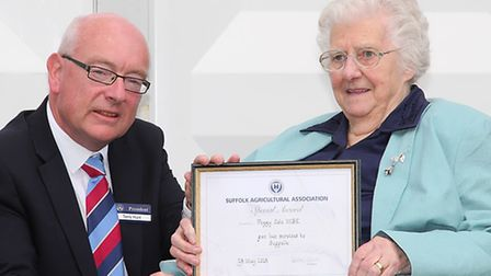 2015 Suffolk Show president Terry Hunt presents Peggy Cole MBE with her Long Service Award.