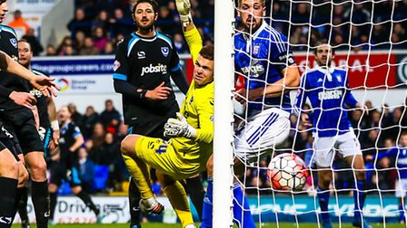 Ryan Fraser's free kick drops into the net behind Luke Chambers and Portsmouth keeper Brian Murphy t