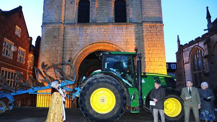 Dean Francis Ward blessing a plough and tractor on the Cathedral Green (near the Norman Tower) in Bu