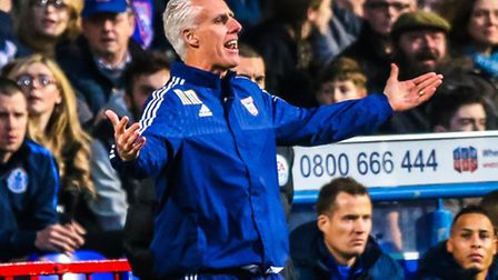 Town manager Mick McCarthy reacts from the touchline after a throw-in goes against Town during the I