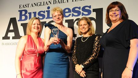 Melissa Abbott and Mary Narey of Muntons receive the EADT Business of the Year trophy from Sarah How