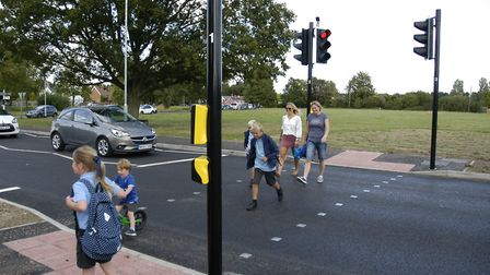 Parents and children using the new crossing in Old Buckenham. Picture: Simon Parkin