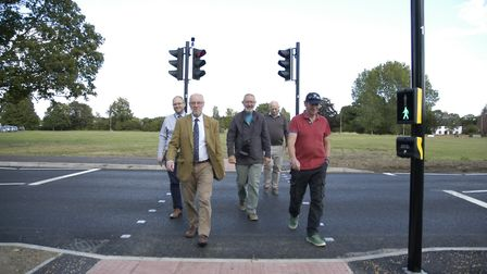 County, district and parish councillors mark the opening of a new pedestrian crossing in Old Buckenh