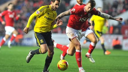 Middlesbrough's Cristhian Stuani (left) and Bristol City's Aden Flint in action during the Sky Bet C