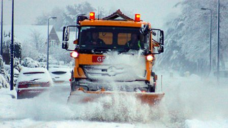 Stock image - a gritting lorry makes its way through the snow