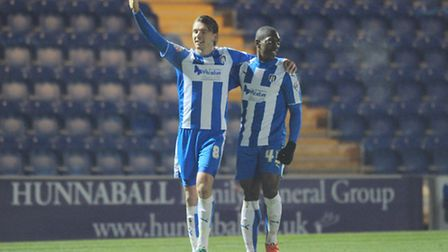 Alex Gilbey celebrates his first-half goal with team-mate Marvin Sordell against Fleetwood tonight.