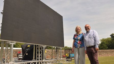 Cllrs Annie Feltham and Tim Young with the giant screen in Colchester's Castle Park last year. Photo