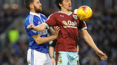 Cole Skuse gets up close to Burnley's Joey Barton