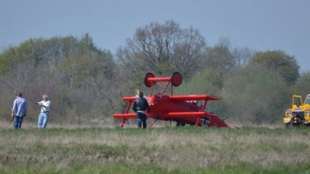 The replica First World War Fokker tri-plane flipped over on take off at Old Buckenham Airfield. Pic