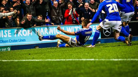 Luke Chambers celebrates his injury time winner for Town with the fans in the Ipswich Town v Queens