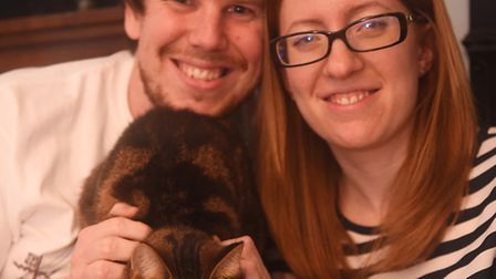 Ben and Claire Titmarsh with their cat Alfie who escaped up the chimney on Boxing Day and had to be