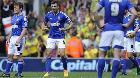 Tommy Smith exhorts his team mates to fight on as Ipswich fall further behind at Norwich