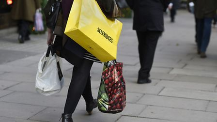 A shopper on Oxford Street in London, as prices in Britain's shops continued to tumble in December i