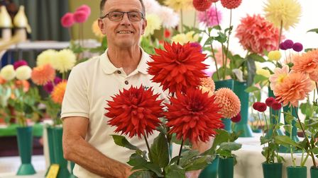 Clive Savage with his dahlia entries at the Diss & District Horticultural Society early autumn show