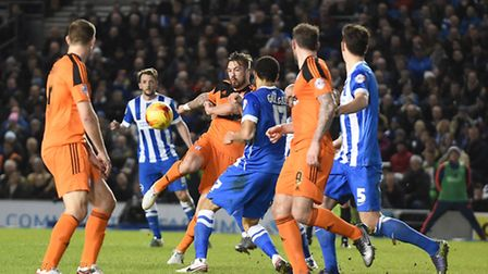 Luke Chambers attempts a volley during the first half at Brighton