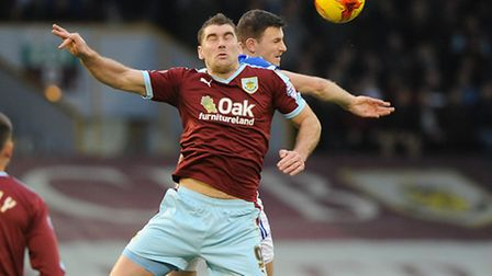 Sam Vokes and Tommy Smith in a grueling battle at Turf Moor on Saturday