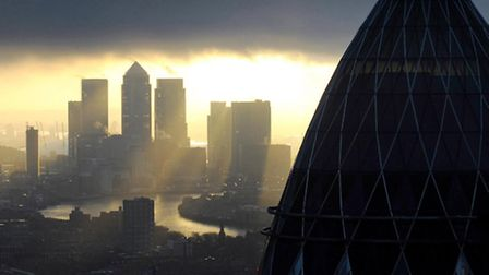 The 'Gherkin' and Canary Wharf at sunrise, as review into Britain's banking culture in the wake of t