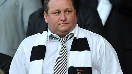 Sports Direct boss Mike Ashley, who has pledged to spend �10million on raising the pay of all the fi