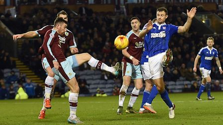 Tommy Smith tries to close down a second half clearance at Burnley
