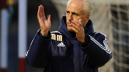 Mick McCarthy acknowledges the travelling Town fans at Burnley