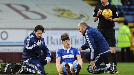 Christophe Berra is dazed after an early collision at Burnley