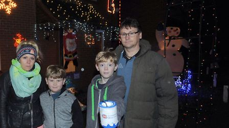 Mark and Donna Crake are pictured with children George (11) and Sam (8) at their home in Bury. The c