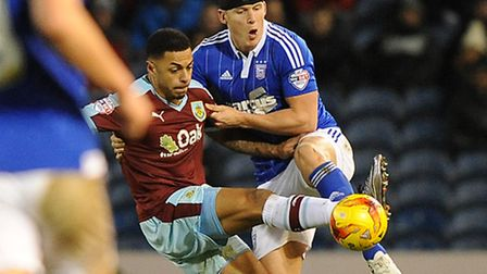 Christophe Berra battles with Andre Gray at Burnley