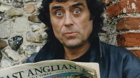 Ian McShane, better known as Lovejoy, reading the East Anglian Daily Times while filming the show in